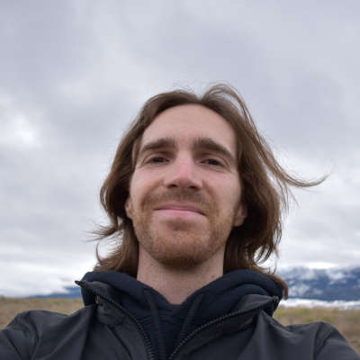 Photo of Bjorn Hansen in front of the Wallowa Mountains