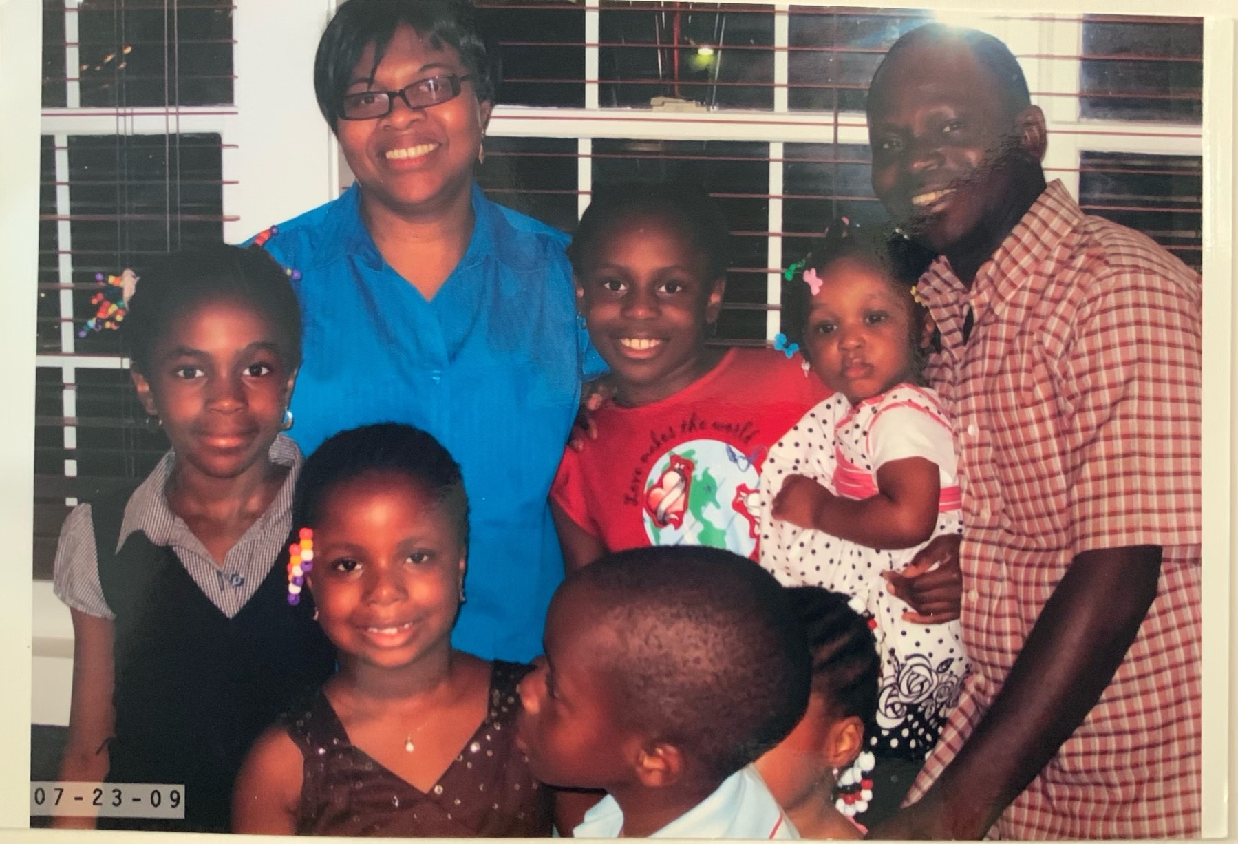 Hope Egie (left) smiles in a family photo with her mother Isimeme Akoko (upper left)