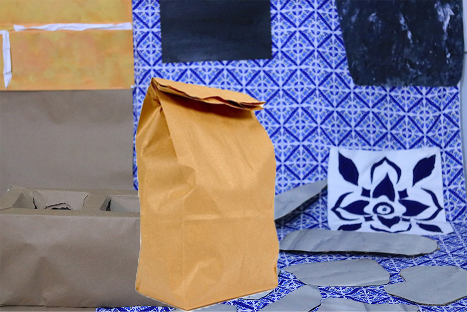 A stuffed brown paper bag sits on the floor of an old kitchen. The kitchen is made of paper and fabric. All it's pieces straddle the present and the past with cinder block, brick, stones, and Portuguese ceramic tiles.
