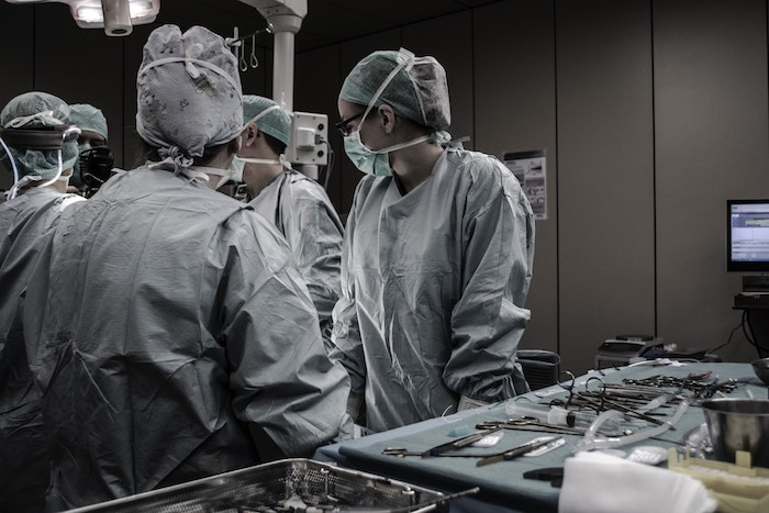 Doctors gathering around a surgery table