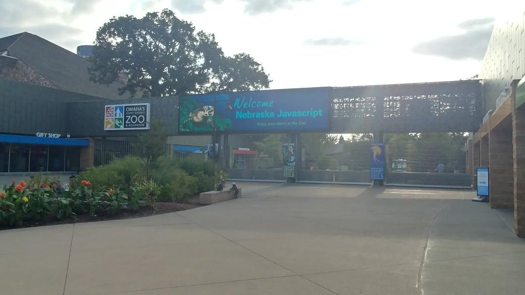 the entrance of Omaha's Henry Doorly Zoo & Aquarium, with a banner that says 'Welcome Nebraska Javascript'